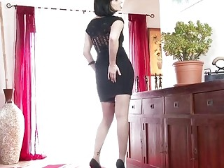 Long legged blonde beauty playing with feet and pussy in stockings